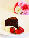 Moist chocolate cake with cream and strawberry for tea time Stock Photo