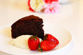 Moist chocolate cake with cream and strawberry for tea time Royalty Free Stock Photography