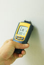Moisture meter metering in wall painting Stock Image