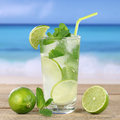 Mojito or caipirinha cocktail drink on the beach while vacation Royalty Free Stock Photo