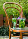 Mojito cocktail built around old chair on garden Royalty Free Stock Image