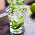 Mojito cocktail close up photo of a cold shot with selective focus Royalty Free Stock Image