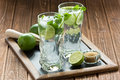 Mojito cocktail refreshing summer drink on rustic wooden table Stock Photos