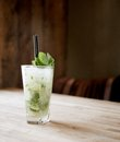 Mojito cocktail in a restaurant on a rustic wooden table Royalty Free Stock Image