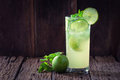 Mojito cocktail in a restaurant on a rustic wooden table Stock Photography