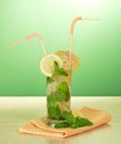 Mojito, cocktail straws, lemon and mint Royalty Free Stock Photo