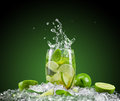 Mojito drink with splash on dark background Stock Image