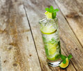 Mojito with a slice of lime on a wooden Stock Photos