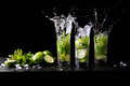 Mojito summer beach refreshing tropical cocktail splash in glass highball alcohol drink with soda water, lime juice Royalty Free Stock Photo