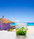 Mojito in tropical purple hut on turquoise beach Royalty Free Stock Image