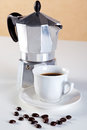 Moka pot and cup of espresso coffee Royalty Free Stock Photo