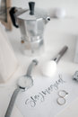 Moka pot and Women`s watches on the table