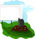 Mole on molehill looking at a billboard small signboard advertisement advertising Stock Images
