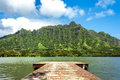 Molii fishpond a pier on looking toward the koolau mountain range at kualoa ranch on oahu hawaii Stock Images