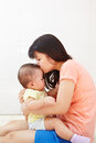 Mom and baby daugher chinese daughter spending their time together Stock Photo