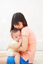 Mom and baby daugher chinese daughter spending their time together Royalty Free Stock Images
