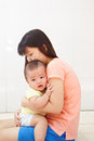Mom and baby daugher chinese daughter spending their time together Stock Image
