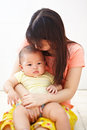 Mom and baby daugher chinese daughter spending their time together Royalty Free Stock Photos