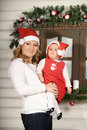 Mom and baby daughter in Christmas Royalty Free Stock Photography