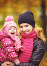 Mom and baby daughter for walk in autumn a the Royalty Free Stock Photo