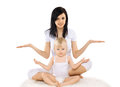 Mom and baby doing exercise gymnastics yoga fitness health concept Stock Photo