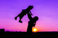 Mom and baby silhouette sunset Royalty Free Stock Image