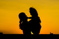 Mom and baby silhouette sunset Stock Photo