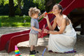 Mom and boy making bubbles Royalty Free Stock Photo