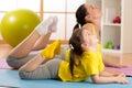 Mom and child doing gymnastics. Family sports Royalty Free Stock Photo