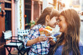 Mom with child eating ice cream in city street Royalty Free Stock Photo
