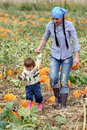 Mom and Child Walking in a Pumpkin Patch Royalty Free Stock Photos