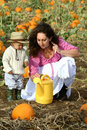 Mom and Child with Watering Can Stock Photography