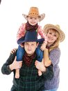Mom dad and little daughter american cowboy costumes my is sitting on s shoulders isolated on white background Royalty Free Stock Photography