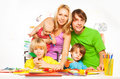 Mom, dad and little kids crafting Royalty Free Stock Photo