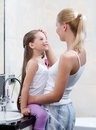 Mom and daughter are in bathroom Royalty Free Stock Images