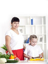 Mom and daughter cooking together Royalty Free Stock Photos