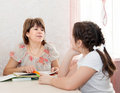Mom and daughter doing homework mature mother helping her child with at home Royalty Free Stock Image