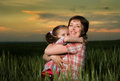Mom and daughter family at sunset Royalty Free Stock Photo