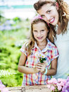 Mom and daughter have fun in the work of gardening spring Stock Photos