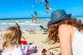 Mom daughter having a great time and child playing on yucatan peninsula beach Stock Photography