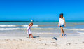 Mom daughter having a great time and child playing on yucatan peninsula beach Royalty Free Stock Photos