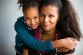 Mom and daughter hug african american hugs her Stock Images