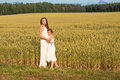 Mom and daughter are hugging in the summer on a wheat field Royalty Free Stock Photo