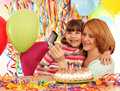 Mom and daughter take pictures at a birthday party Stock Image