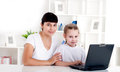 Mom and daughter are working together for a laptop Royalty Free Stock Images