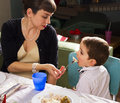 Mom feeds her son on thanksgiving turkey retro mother holiday Royalty Free Stock Images