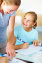 Mom helping her daughter with homework Stock Photography