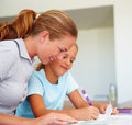 Mom helping her daughter with homework Royalty Free Stock Photos
