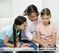 Mom helping kids with homework Royalty Free Stock Images