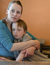 Mom hugging sad child mother hugs her crying year old son Royalty Free Stock Photos